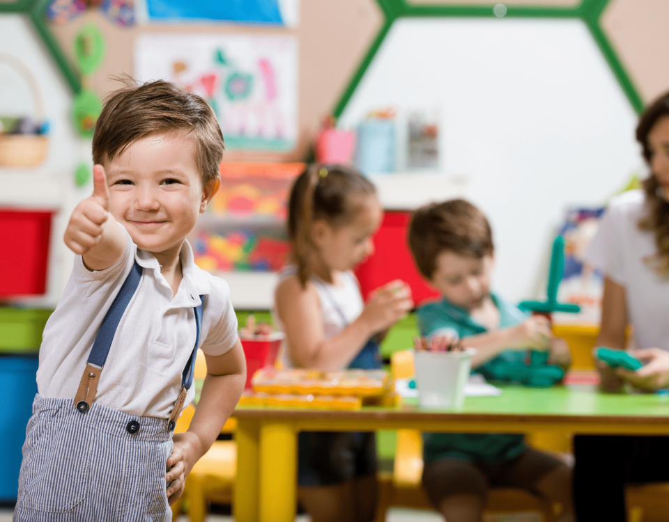 boy in classroom giving thumbs up- tlc schools- plano, tx